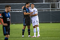 SAN JOSE, CA - SEPTEMBER 13: Oswaldo Alanis #4 of the San Jose Earthquakes greets Javier Hernandez #14 of the LA Galaxy during a game between Los Angeles Galaxy and San Jose Earthquakes at Earthquakes Stadium on September 13, 2020 in San Jose, California.
