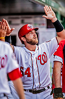 26 September 2018: Washington Nationals catcher Spencer Kieboom comes back to the dugout after scoring in the 2nd inning against the Miami Marlins at Nationals Park in Washington, DC. The Nationals defeated the visiting Marlins 9-3, closing out Washington's 2018 home season. Mandatory Credit: Ed Wolfstein Photo *** RAW (NEF) Image File Available ***