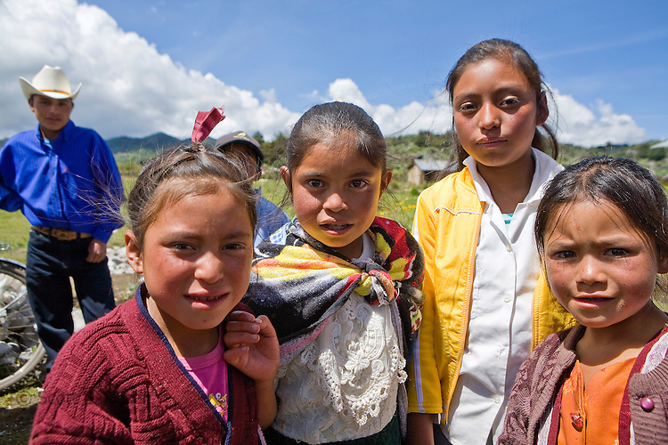 Four girls pose near a church in San Nicolas, Western Highlands, Guatemala