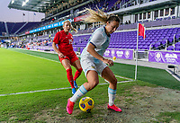 ORLANDO, FL - FEBRUARY 21: Adriana Leon #19 of Canada follows Adriana Sachs #21 of Argentina out of bounds during a game between Canada and Argentina at Exploria Stadium on February 21, 2021 in Orlando, Florida.
