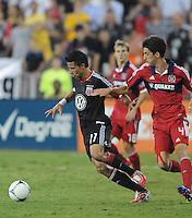 D.C. United midfielder Marcelo Saragosa (11) shields the ball from Chicago Fire midfielder Alvaro Fernadez (4) D.C. United defeated The Chicago Fire 4-2 at RFK Stadium, Wednesday August 22, 2012.