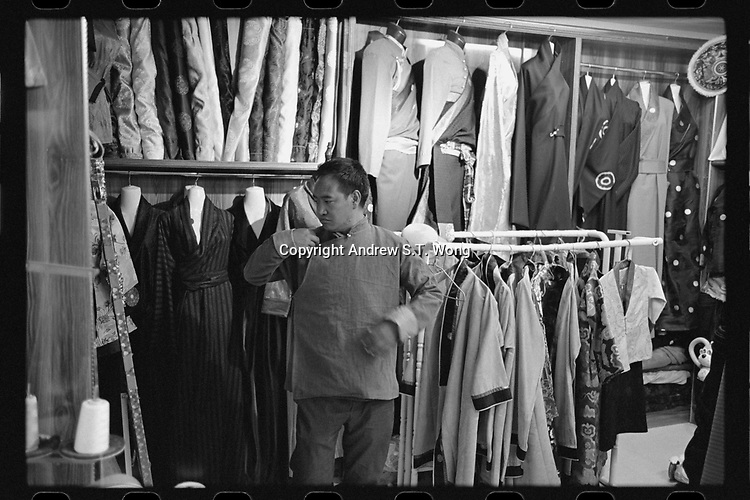 Nangqen County, Yushu Tibetan Autonomous Prefecture, Qinghai Province, China - A Tibetan man tries on traditional costumes at a shop, August 2019.