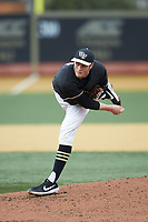 Wake Forest Demon Deacons starting pitcher Colin Peluse (8) follows through on his delivery against the Illinois Fighting Illini at David F. Couch Ballpark on February 16, 2019 in  Winston-Salem, North Carolina.  The Fighting Illini defeated the Demon Deacons 5-2. (Brian Westerholt/Four Seam Images)