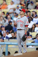 Joey Votto #19 of the Cincinnati Reds at first base during a game against the Los Angeles Dodgers at Dodger Stadium on July 3, 2012 in Los Angeles, California. Los Angeles defeated Cincinnati 3-1. (Larry Goren/Four Seam Images)