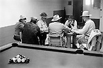 Aztec, New Mexico, June 1971. Men playing dominoes in a bar with a pool table.  1970s USA