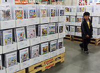 A young boy looks at DS Nintendo at a Costco outlet, Tokyo, Japan. Costco has seen a surge in customers, who are able to buy in bulk at wholesale prices, as the economy has taken a down-turn..
