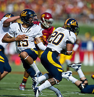 LOS ANGELES, CA - September 22, 2012:  Cal Bears quarterback Zach Maynard (15) hands off the ball to running back Isi Sofele (20) during the USC Trojans vs the Cal Bears at the Los Angeles Memorial Coliseum in Los Angeles, CA. Final score USC 27, Cal 9..