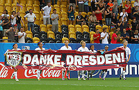 """USA's players with a banner (""""Danke, Dresden"""" - Thanks, Dresden) after winning the game against Switzerland 5:0 during the FIFA U20 Women's World Cup at the Rudolf Harbig Stadium in Dresden, Germany on July 17th, 2010."""