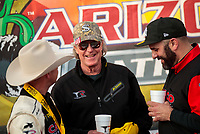 Feb 23, 2020; Chandler, Arizona, USA; Bobby Lagana and Richard Hogan crew members for NHRA top fuel driver Steve Torrence celebrate after winning the Arizona Nationals at Wild Horse Pass Motorsports Park. Mandatory Credit: Mark J. Rebilas-USA TODAY Sports