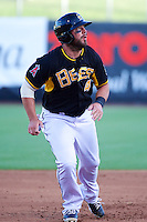 Ian Stewart (4) of the Salt Lake Bees in action against the Nashville Sounds in Pacific Coast league action at Smith's Ballpark on June 23, 2014 in Salt Lake City, Utah.  Stewart, from the Los Angeles Angels of Anaheim, was in the lineup for a rehab stint with the Bees.  (Stephen Smith/Four Seam Images)