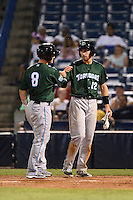 Daytona Tortugas third baseman Taylor Sparks (12) fist bumps Joe Hudson (8) after scoring on a Sammy Diaz (not shown) home run during a game against the Tampa Yankees on April 24, 2015 at George M. Steinbrenner Field in Tampa, Florida.  Tampa defeated Daytona 12-7.  (Mike Janes/Four Seam Images)