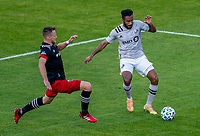 WASHINGTON, DC - NOVEMBER 8: Frederic Brillant #13 of D.C. United defends Amar Sejdic #14 of the Montreal Impact during a game between Montreal Impact and D.C. United at Audi Field on November 8, 2020 in Washington, DC.