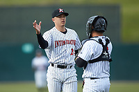 Kannapolis Intimidators relief pitcher Tyler Johnson (21) celebrates with catcher Carlos Perez (8) after closing out the game against the Lakewood BlueClaws at Kannapolis Intimidators Stadium on April 8, 2018 in Kannapolis, North Carolina.  The Intimidators defeated the BlueClaws 4-3 in game two of a double-header.  (Brian Westerholt/Four Seam Images)