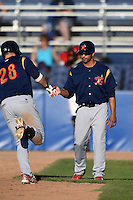 State College Spikes manager Oliver Marmol (7) congratulates Rowan Wick (28) after hitting a home run during a game against the Batavia Muckdogs on June 22, 2014 at Dwyer Stadium in Batavia, New York.  State College defeated Batavia 10-3.  (Mike Janes/Four Seam Images)