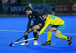Australia's Trent Mitton tries to tackle NZ's Dominic Newman during the Sentinel Homes Trans Tasman Series hockey match between the New Zealand Black Sticks Men and the Australian Kookaburras at Massey University Hockey Turf in Palmerston North, New Zealand on Tuesday, 1 June 2021. Photo: Dave Lintott / lintottphoto.co.nz