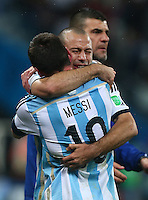 A tearful Javier Mascherano of Argentina hugs Lionel Messi as they celebrate after winning the penalty shootout