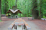 Along the famous Avenue of the Giants in Humboldt Redowoods State Park, California, a picnic area features large table and covered kiosk with fireplaces along the Eel River.  Humboldt Redwoods State Park is along U.S. HIghway 101 north of San Francisco, California along the North Coast.