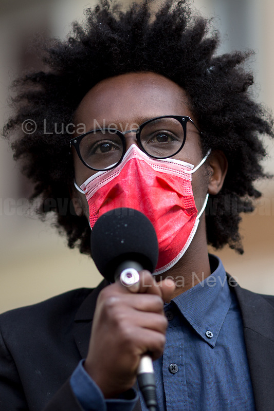 """Amin Nour (Actor).<br /> <br /> Rome, Italy. 21st Apr, 2021. Today, Liberare Roma and NiBi (Neri Italiani - Black Italians) held a flash-mob in Piazza San Silvestro (1.) to call the Italian Government led by Mario Draghi (Government supported by all the Italian Parties except the right wing Party Fratelli d'Italia) 2.) to finally make the long awaited reform of the citizenship law which will give the Italian Citizenship to the children who are born and grown up in Italy once called """"Ius Soli"""" or """"Ius Culturae"""" Law. <br /> «I was born here in Italy, I grew up here, I live here, I study here, I love here, I live and plan my future here. However, I do not have the same rights of all the other Italians» (1.).<br /> <br /> Footnotes and Links:<br /> 1. http://bit.do/fQy7U <br /> 2. http://bit.do/fQy9F  <br /> Previous Demos: <br /> - First Conte's Government (Centre-Right) http://bit.do/fi83r <br /> - Second Conte's Government (Centre-Left) http://bit.do/fJ2pc<br /> - Second Conte's Government (Centre-Left) http://bit.do/fQy9F"""