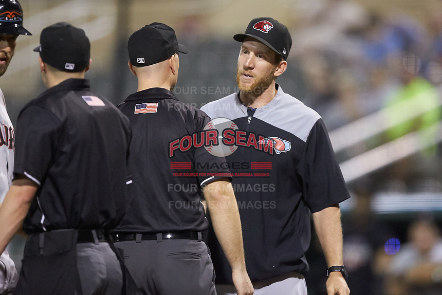 Umpire Chris Silvestri gets in between Hickory Crawdads hitting coach Jared Goedert (8) and home plate umpire Matt Baldwin after Goedert was ejected from the game against the Piedmont Boll Weevils at Kannapolis Intimidators Stadium on May 3, 2019 in Kannapolis, North Carolina. The Boll Weevils defeated the Crawdads 4-3. (Brian Westerholt/Four Seam Images)