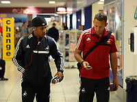 Wednesday 28 August 2013<br /> Pictured L-R: Wayne Routledge and Scout Erik Larsen at Cardiff Airport.<br /> Re: Swansea City FC players and staff en route for their UEFA Europa League, play off round, 2nd leg, against Petrolul Ploiesti in Romania.