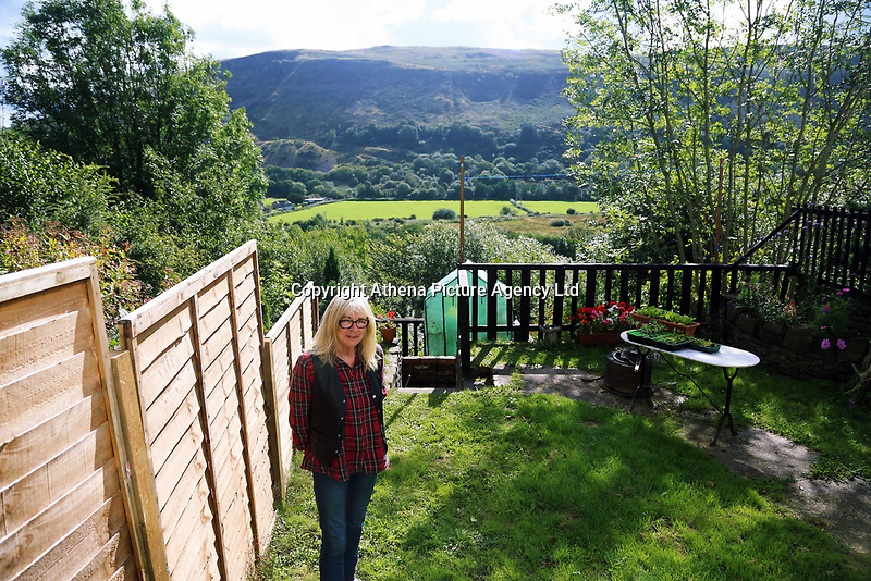Pictured: Home owner Debbie Pain in the back garden of her house. Thursday 31 August 2017<br /> Re: Home owners and tennants have been served to evacuation orders by Neath Port Talbot County Council over fears that a landslip has made their houses unsafe in Cyfyng Road, Ystalyfera, Wales, UK.