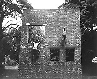 Two Jeds scale brick wall in training exercises.  Milton hall, England, ca.  1944. (OSS)<br /> Exact Date Shot Unknown<br /> NARA FILE #:  226-FPL-MH-126<br /> WAR & CONFLICT BOOK #:  736