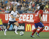 USWNT midfielder Lauren Cheney (12) brings the ball forward. In an international friendly, the U.S. Women's National Team (USWNT) (white/blue) defeated Korea Republic (South Korea) (red/blue), 4-1, at Gillette Stadium on June 15, 2013.