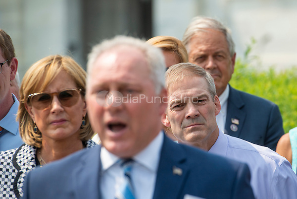 United States Representative Claudia Tenney (Republican of New York), left, and United States Representative Jim Jordan (Republican of Ohio), right, listen as United States House Minority Whip Steve Scalise (Republican of Louisiana), center, offers remarks during a press conference regarding an Amicus Brief urging the Supreme Court to overturn a 110 year-old New York gun law that imposes limits on carrying weapons outside of the home, at the US Capitol in Washington, DC, Tuesday, July 20, 2021. Credit: Rod Lamkey / CNP /MediaPunch