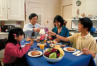 CHINESE-AMERICAN FAMILY EATING A HEALTHY BREAKFAST IN KITCHEN. CHINESE AMERICAN FAMILY. SAN FRANCISCO CALIFORNIA.
