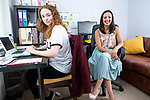 © Joel Goodman - 07973 332324 . 04/08/2017 . Newton-le-Willows , UK . Bunion-sufferer JENNIFER BAILEY (r) , pictured in her home office with Marketing Intern BETH RIGBY (23) (l) , imports custom-made designer shoes manufactured for people with foot conditions which make wearing conventional shoes uncomfortable . Photo credit : Joel Goodman