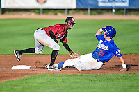Idaho Falls Chukars second baseman D.J. Burt (1) fields the throw against a sliding Gage Green (21) of the Ogden Raptors in Pioneer League action at Lindquist Field on August 27, 2015 in Ogden, Utah. Ogden defeated the Chukars 4-3.  (Stephen Smith/Four Seam Images)