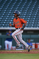 AZL Giants Orange Javeyan Williams (34) crosses home plate during an Arizona League game against the AZL Cubs 1 on July 10, 2019 at Sloan Park in Mesa, Arizona. The AZL Giants Orange defeated the AZL Cubs 1 13-8. (Zachary Lucy/Four Seam Images)