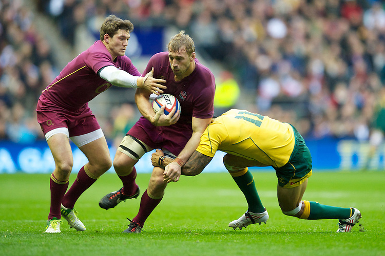 Chris Robshaw of England (centre) is tackled by Benn Robinson of Australia as Alex Goode of England supports during the Cook Cup between England and Australia, part of the QBE International series, at Twickenham on Saturday 17th November 2012 (Photo by Rob Munro)