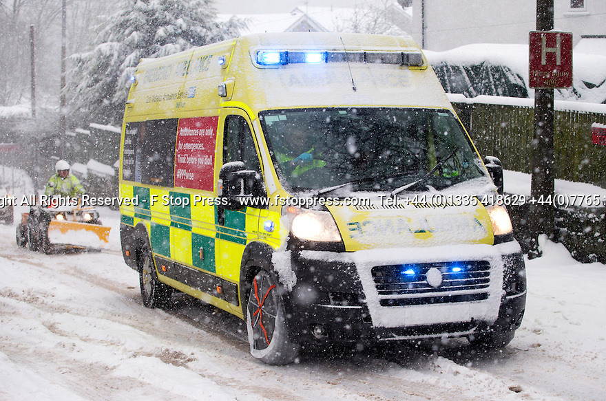 29/01/15<br /> <br /> An ambulance gets stuck and its crew are forced to fit 'snow socks' to get it going again.<br /> <br /> Heavy snowfall results in multiple accidents, stranded vehicles and traffic chaos as the wintery weather does its best to shut down theDerbyshire Peak District town of Buxton.<br /> <br /> All Rights Reserved - F Stop Press.  www.fstoppress.com. Tel: +44 (0)1335 418629 +44(0)7765 242650