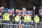 """© Joel Goodman - 07973 332324 . 03/11/2017 . Manchester , UK . Counter protest organised by Unite Against Fascism . Fans of Tommy Robinson (real name Stephen Yaxley-Lennon ) and anti-fascist counter demonstrators at the launch of the former EDL leader's book """" Mohammed's Koran """" at Castlefield Bowl . Originally planned as a ticket-only event at Bowlers Exhibition Centre , the launch was moved at short notice to a public location in the city . Photo credit : Joel Goodman"""