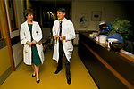 NHS 1980s doctor Dr Maura Stafford with consultant Mr Bamford, they are doing a Ward Round. Royal United Bath Hospital Somerset. 1989.
