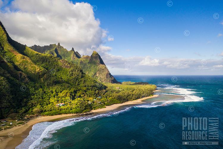 An aerial view of Tunnels Beach, Ha'ena, Kaua'i; Mount Makana (nicknamed Bali Hai) is on the right of the mountain range.
