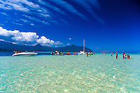 Sailboats and motorboats anchor on the shallow sand bars in the calm waters of Kaneohe Bay, windward Oahu.