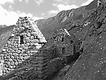 Black and white photo of stone building at Machu Picchu near Cusco, Peru.