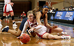 SIOUX FALLS, SD - MARCH 6: Chloe Lamb #22 of the South Dakota Coyotes is found while diving for the loose ball by Camryn Hill #12 of the Oral Roberts Golden Eagles during the Summit League Basketball Tournament at the Sanford Pentagon in Sioux Falls, SD. (Photo by Dave Eggen/Inertia)