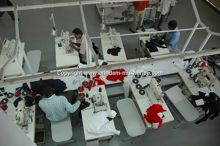 Indian men working at Srinidhi garment stitching factory in Tirupur, Tamilnadu. After lifting of quota system in textile export on 1st january 2005. Tirupur has become the biggest foreign currency earning town of India.
