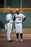 """Delmarva Shorebirds pitcher Juan Echevarria (38) """"interviews"""" fellow pitcher Nick Vespi (26) before a South Atlantic League game against the Greensboro Grasshoppers on August 21, 2019 at Arthur W. Perdue Stadium in Salisbury, Maryland.  Delmarva defeated Greensboro 1-0.  (Mike Janes/Four Seam Images)"""