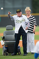 Mr. Raymond Garrison, a World War II veteran who turned 100 years old in April of 2015, throws out a ceremonial first pitch prior to the Appalachian League game between the Bluefield Blue Jays and the Burlington Royals at Burlington Athletic Park on July 1, 2015 in Burlington, North Carolina.  The Royals defeated the Blue Jays 5-4. (Brian Westerholt/Four Seam Images)