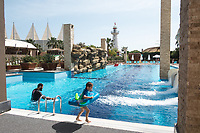 A father and son play in the men only section of the Adenya Hotel and Resort swimming pool. Halal hotels have sex segregated swimming pools, beaches, and spa facilities.