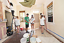 Tulane student Chase Kelly helps Delaney Connor and others paint a living room while volunteering with South Seventh Ward Neighbors, 2016.