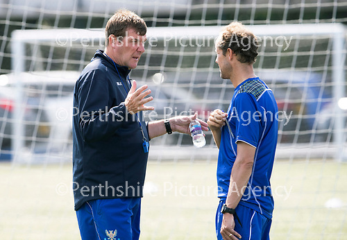 St Johnstone Training….27.07.18<br />Manager Tommy Wright talking with Assistant Manager Alec Cleland during training on the artificial pitch at McDiarmid Park this morning in preparation for tomorrow's Betfred Cup game at Forfar.<br />Picture by Graeme Hart.<br />Copyright Perthshire Picture Agency<br />Tel: 01738 623350  Mobile: 07990 594431