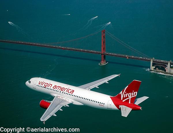 aerial photograph of N628VA, a Virgin America Airbus A320-214, approaching the Golden Gate bridge, San Francisco, California