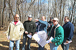 WATERBURY,  CT.- 19 MARCH  2011 031911JW02- Waterbury City Plan Commision members Ron Marciano, Pete MacCasland, Cissie Rice, Jim Sequin, Ray Work Commission Chairman, and Rich LaBrecque listen as engineer and land surveyor Scott Meyers points out details during a site walk Saturday afternoon, of a parcel of land at 282 Oakville Ave. in Waterbury to evaluate if the property is appropriate for a large housing project.<br /> Jonathan Wilcox Republican American