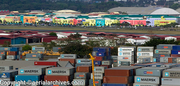 aerial photographs of containers stored at the Port of Balboa across hangars and the runway of Gelabert Airport toward the Albrook Mall; Panama City Panama