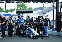 Apr. 27, 2012; Baytown, TX, USA: NHRA crew members for top fuel dragster driver J.R. Todd during qualifying for the Spring Nationals at Royal Purple Raceway. Mandatory Credit: Mark J. Rebilas-